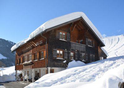Ferienwohnungen-Beer-Schoppernau-Haus-Winter-1